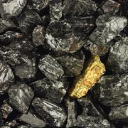 Golden nugget on coals background close-up - stock photo