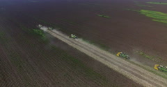 Aerial view crop width combine harvesters in cloud of dust Stock Footage