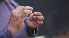 Woman sewing a traditional basket in the North of Argentina Close Up Stock Footage