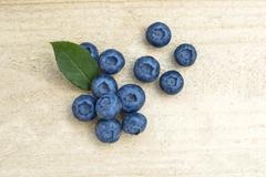 Stock Photo of Fresh blueberries on a wooden table.
