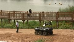 Stock Video Footage of Amstaf- amphibian, unmanned, ground vehicle tries to avoid a human