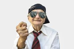 Elderly woman showing fig sign. - stock photo