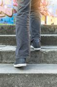 Stock Photo of Person walking on stairs.