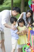 Stock Photo of Parents and children buying toys
