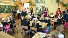 First class schoolchildren listen a teacher in classroom, Russia - stock footage