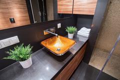 Modern washbasin in luxury toilet - stock photo