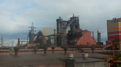 Huge blast furnace works and smokes at integrated metallurgical plant NTMK Stock Footage