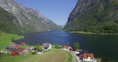Traditional farm hamlet along Nærøyfjord, Gudvangen, Aurland, Norway - stock footage