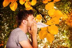 Composite image of close up side view of man blowing nose Stock Photos