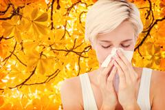 Composite image of sick woman blowing her nose Stock Photos