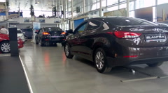 Hyundai Elantra and other cars are in auto dealership showroom Stock Footage