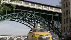 Elevated 1 subway train track and taxi cab on 125th Street in Harlem in 4K NYC Stock Footage