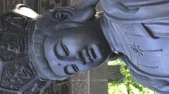 Statue of Bodhisattva Avalokitesvara (Guanyin)Vertical footage Stock Footage