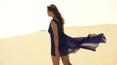 Lost, young woman walking on desert, slow motion shot at 240fps Stock Footage