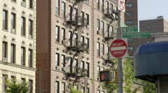 do not enter sign on 125 st in Harlem with cars driving by in 4K NYC - stock footage