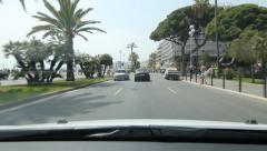 Driving on the Promenade des Anglais past park in Nice, France. Stock Footage