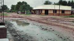 Building in a flooded road in Ingeniero Juarez Stock Footage