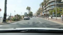 Driving on the Promenade des Anglais past hotels and apartments in Nice, France. Stock Footage