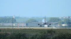 Lufthansa Embraer ERJ-190LR D-AECA landing on runway 25R Stock Footage