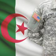 American soldier with flag on background - Algeria - stock photo