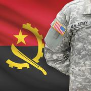 American soldier with flag on background - Angola - stock photo