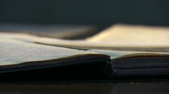 Old vintage diary memo book opened to reveal yellow, stained pages Stock Footage