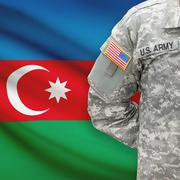 American soldier with flag on background - Azerbaijan - stock photo