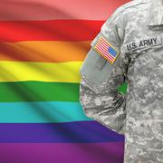 American soldier with flag on background - LGBT people - stock photo