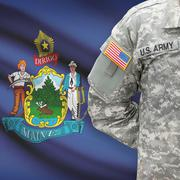 American soldier with US state flag on background - Maine Kuvituskuvat