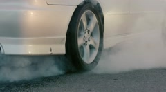 The Car Does Drift On Asphalt.Tire Smoking Heavily, Close-Up. Slow motion Stock Footage