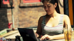 Young female student finish working on laptop and taking coffee break in cafe - stock footage