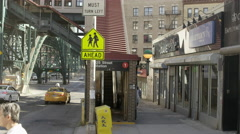 Elevated subway station for 1 train on 125th Street in Harlem on early morning Stock Footage