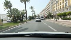 Driving on the Promenade des Anglais past hotels in Nice, France. Stock Footage
