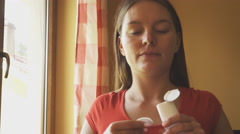 Woman cleaning face with cotton swab pad. 4K - stock footage
