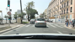 Driving on the Promenade des Anglais past the Hotel Negresco in Nice, France. Stock Footage