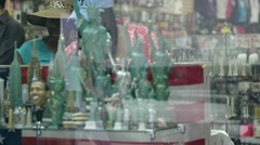 Statue of Liberty toy models in Times Square gift shop seen through glass window Stock Footage