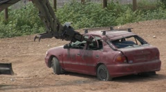 Police Bomb Disposal Bobcat robot removes the roof of a bomb car  - stock footage