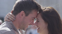 4K Attractive romantic couple embrace outdoors in the city Stock Footage