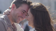 4K Attractive romantic couple embrace outdoors in the city - stock footage