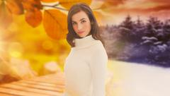 Composite image of pretty brunette in white jumper posing - stock photo