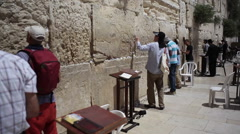 Religious and orthodox jews pray at the Wailing Wall, Jerusalem, Israel - stock footage