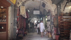 People shop in middle east market in Jerusalem old ancient city, Israel Stock Footage