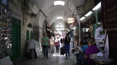 People walk in middle east market in Jerusalem old ancient city, Israel Stock Footage