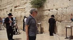 Stock Video Footage of Orthodox Jews pray at the Wailing Wall, Jerusalem, Israel