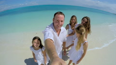 Selfie portrait of happy young Caucasian family on beach Stock Footage