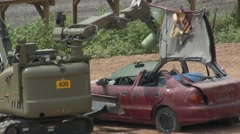 Police Bomb Disposal Bobcat robot removes a bomb from a car Stock Footage