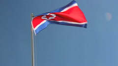 North Korea flag in front of blue sky Stock Footage