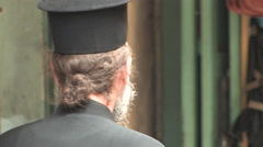 Orthodox Priest in the Old City of Jerusalem Stock Footage