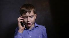 Teen boy talking on the phone emotion studio background in blue shirt Video - stock footage