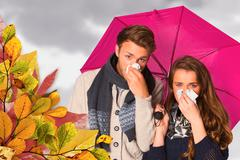 Composite image of couple blowing nose while holding umbrella - stock photo